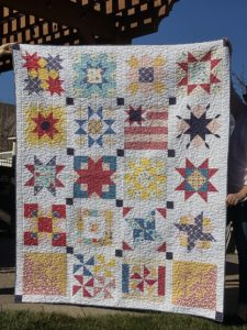 Sampler quilt with stars made by three friends